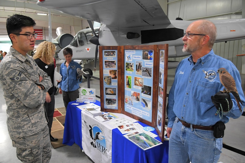 (Left to right) Airman 1st Class Andrew Lee, 729th Air Control Squadron, talks with Buz Marthaler, a representative with Wildlife Rehabilitation Center of Northern Utah, during the 2019 Combined Federal Campaign Kickoff and Exposition event held at the Hill Aerospace Museum Nov. 4, 2019, at Hill Air Force Base, Utah. The CFC is schedule to run Nov. 4 through Dec. 15 at Hill AFB. (U.S. Air Force photo by Todd Cromar)