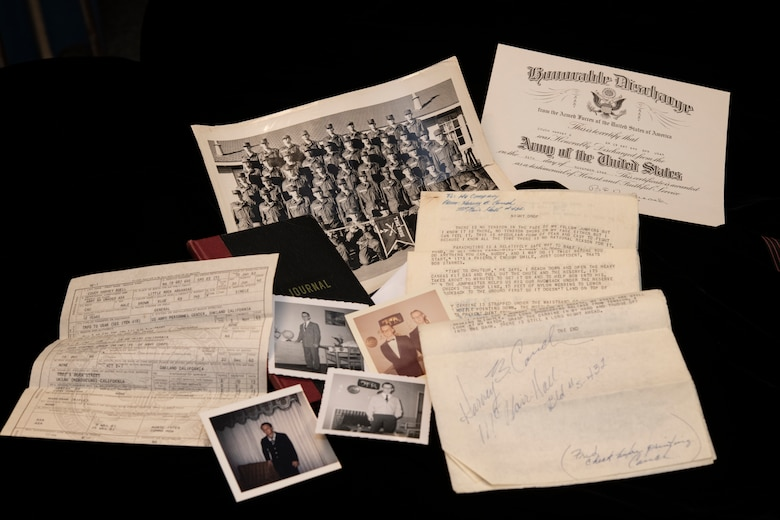 Historical documents and memorabilia belonging to Specialist 5th Class Harvey Couch are displayed