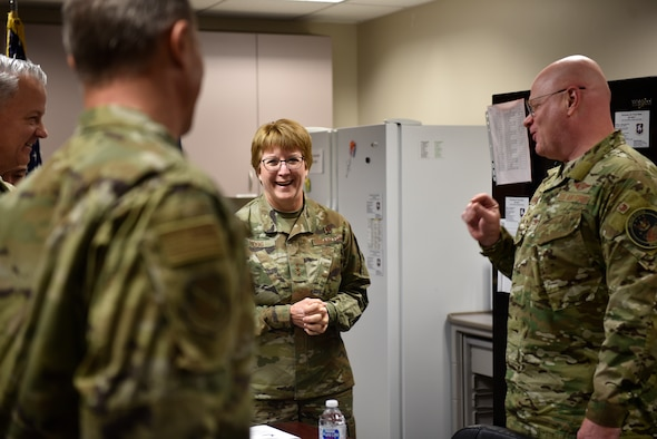 Lt. Gen. Dorothy Hogg, U.S. Air Force Surgeon General, visits with 21st Medical Group leadership at Schriever Air Force Base, Colorado, Nov. 1, 2019. The visit started with a mission briefing and was then followed by a tour of the facilities, where Hogg was able to meet Airmen and ask them about their jobs and what they might need to better accomplish the mission. (U.S. Air Force photo by Airman Alexis Christian)
