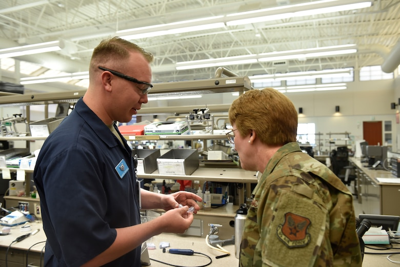 Lt. Gen. Dorothy Hogg, U.S. Air Force Surgeon General, looks over work done by Staff Sgt. Samuel Pennell, 21st Operational Medical Readiness Squadron dental laboratory technician, at the Area Dental Laboratory on Peterson Air Force Base, Colorado, Nov. 1, 2019. The Peterson dental lab creates night guards, retainers, and dental implants for members across the Air Force. (U.S. Air Force photo by Airman Alexis Christian)