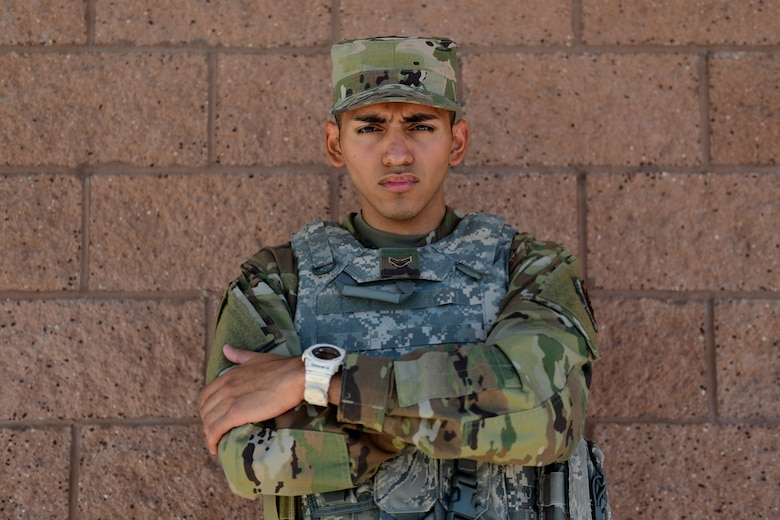 Portrait of an Airman standing in front of a brick wall