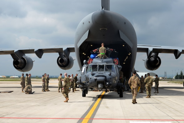 Maintainers from the 56th Helicopter Maintenance Unit and logistics readiness specialist from the 31st Fighter Wing, load an HH-60G Pave Hawk helicopter into a C-17 Globemaster III, prior to a deployment, at Aviano Air Base, Italy, May 22, 2019.  The primary mission of the HH-60G Pave Hawk helicopter is to conduct day or night personnel recovery operations into hostile environments to recover isolated personnel during war. (U.S. Air Force photo by Airman 1st Class Ericka A. Dechane).