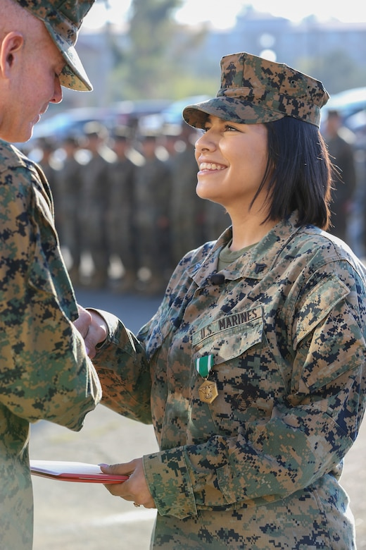 U.S. Marine Cpl. Alexandra Nowak, an administrative specialist with Alpha Company, Headquarters and Support Battalion, Marine Corps Installations West, Marine Corps Base Camp Pendleton, receives a Navy and Marine Corps Commendation Medal from by Brig. Gen. Dan Conley, the commanding general for MCI-West, MCB Camp Pendleton, during an award ceremony on Camp Pendleton, California, Nov. 6, 2019. Nowak received the award for her actions to save a family after a car crash on Interstate Highway 15. Nowak is a native of Forney, Texas.