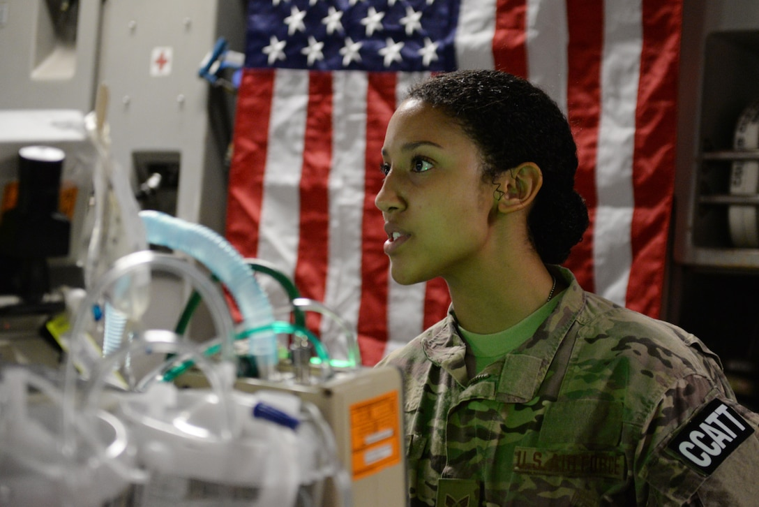 U.S. Air Force Senior Airman Natalie Hives, 455th Expeditionary Aeromedical Evacuation Squadron Critical Care Air Transport Team respiratory therapist deployed from the 60th Medical Group at Travis Air Force Base, California, relays her patient's oxygen statistics prior to an aeromedical evacuation mission aboard a C-17 Globemaster III aircraft from Bagram Airfield, Afghanistan, to Ramstein Air Base, Germany, Aug. 8, 2015. The 455th EAES' CCATT is a three-person, highly specialized medical team consisting of a physician who specializes in an area of critical care or emergency medicine, a critical care nurse and a respiratory therapist. The CCATT is charged with providing critical care to the sick and wounded as they are moved thousands of miles onboard U.S. cargo aircraft to receive full-time care elsewhere. (U.S. Air Force photo by Maj. Tony Wickman/Released)