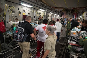U.S. Army Maj. Julie Rizzo, center, burn surgeon and team lead from San Antonio Military Medical Center in Joint Base San Antonio, Texas, directs personnel while loading patients onto an Air Force C-17 Globemaster III during a humanitarian mission, June 6, 2018. The C-17 Globemaser III aircrew from the Mississippi Air National Guard's 172nd Airlift Wing, transported six children from Guatemala to receive medical treatment in Galveston, Texas, for burns and other injuries sustained during the recent Fuego Volcano eruption, which started June 3. (U.S. Air Force photo by Master Sgt. Keyonna Fennell)