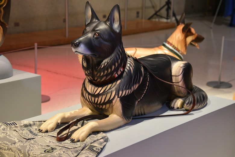 A wooden dog sculpture of former USAF military working dog Robson L096.