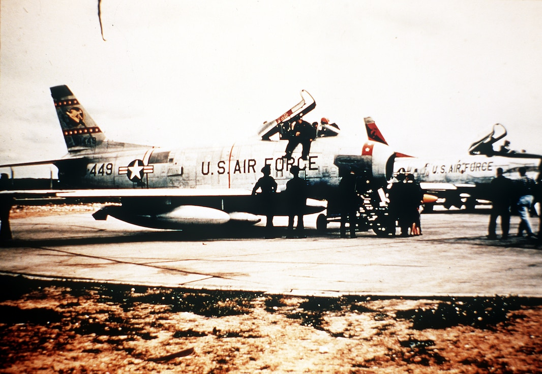 An F-86H Sabre Hog tactical nuclear bomber from the 50th Tactical Fighter Wing, rests on a runway in 1956. The 50th Space Wing traces its origins back to World War II, when the 50th Fighter Group provided close air support during the D-Day invasion. (U.S. Air Force courtesy photo)