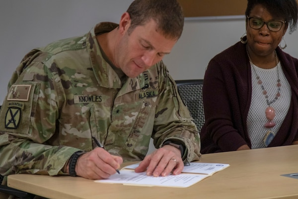Brig. Gen. Charles Lee Knowles signs a charter for the Commander's Ready and Resilient Council program as part of the Alaska National Guard's Soldier care at Joint Base Elmendorf-Richardson, Nov. 6, 2019. The program is designed to align with the state suicide prevention plan of identifying and preventing high-risk behaviors in Soldiers and families.