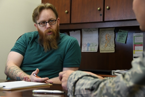 Ryan Lynn, Veterans Affairs veterans benefits advisor, discusses with an Airman about the retirement benefits that are available to him Nov. 5, 2019, at McConnell Air Force Base, Kan. Lynn provides service members, family members and veterans, assistance and a better understanding of the benefits they are entitled to once they retire. (U.S. Air Force photo by Airman 1st Class Nilsa E. Garcia)