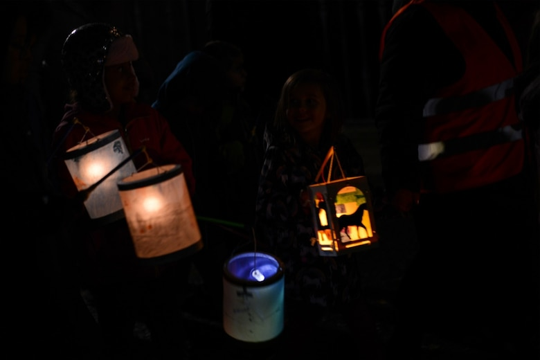 Children from the Kaiserslautern Military Community walk with lanterns in celebration of Martinstag in Landstuhl, Germany, Nov. 7, 2019.