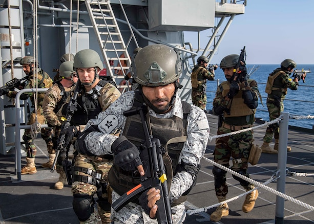 GULF OF OMAN (Nov. 6, 2019) Pakistan Navy sailors and members of the visit, board, search, and seizure (VBSS) team assigned to the guided-missile cruiser USS Normandy (CG 60) execute tactical movements as part of a VBSS drill during International Maritime Exercise 2019 (IMX 19). The exercise is a multinational engagement involving partners and allies from around the world designed to facilitate the sharing of knowledge and experiences across the full spectrum of defensive maritime operations. IMX 19 serves to demonstrate the global resolve in maintaining regional security and stability, freedom of navigation and the free flow of commerce from the Suez Canal south to the Bab el-Mandeb Strait through the Strait of Hormuz to the Northern Arabian Gulf. (U.S. Navy photo by Mass Communication Specialist 2nd Class Michael H. Lehman)