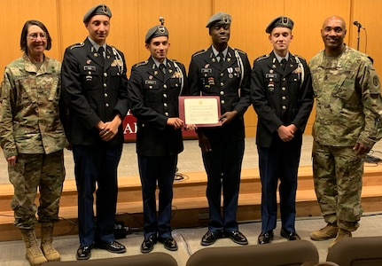 BAMC Commanding General Brig. Gen. Wendy Harter and Command Sgt. Maj. Thomas Oates present a certificate of appreciation to the Wagner High School Junior ROTC Color Guard during the Veterans Day ceremony at Brooke Army Medical Center Nov. 1.