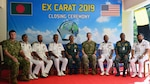 U.S. and Bangladesh Navy senior delegates come together for a group photo during the closing ceremony of Cooperation Afloat Readiness and Training (CARAT) Bangladesh 2019. This year marks the 25th iteration of CARAT, a multinational exercise designed to enhance U.S. and partner navies' abilities to operate together in response to traditional and non-traditional maritime security challenges in the Indo-Pacific region.