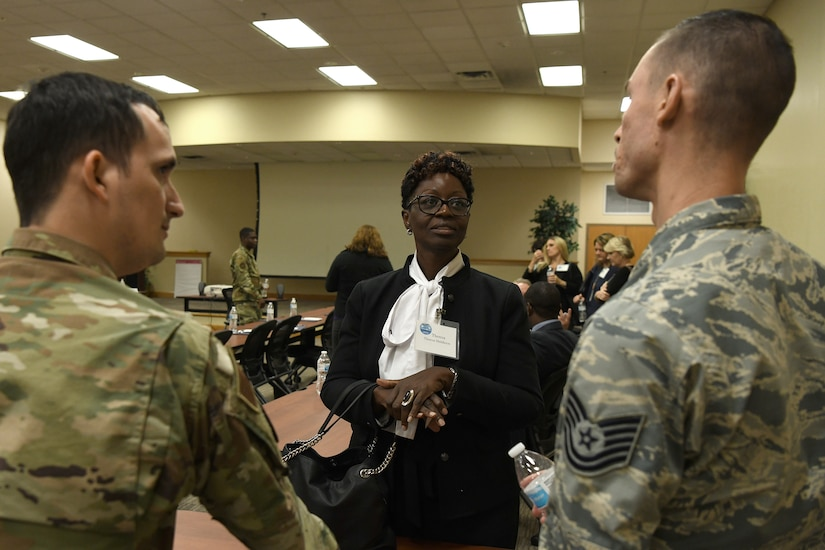 Teresa Middleton, principal of Miracle Academy, talks to Air Force recruiters at Joint Base Charleston Nov. 7, 2019, as part of a continuing effort to strengthen collaboration between leaders from the base and local community.
