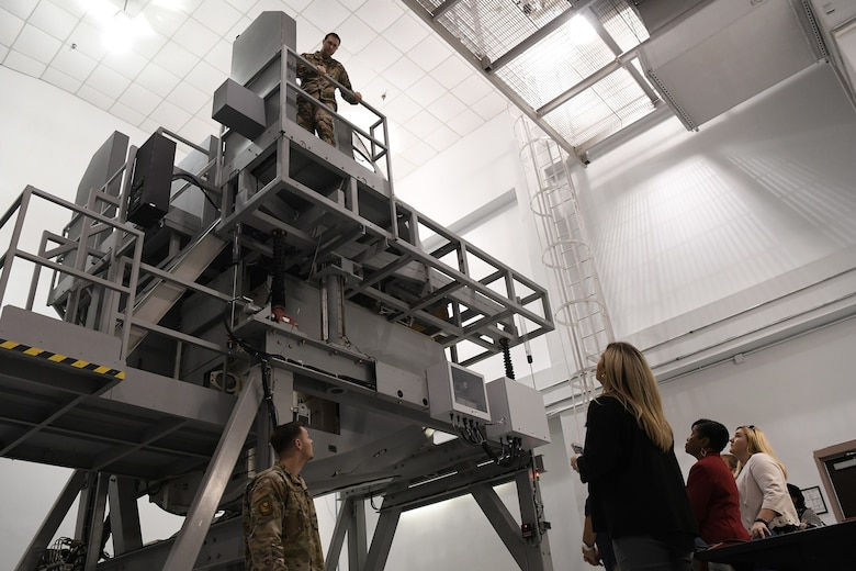 Instructors with the 373rd training detachment show guests a simulation of C-17 Globemaster III landing gear used for training at Joint Base Charleston Nov. 7, 2019, as part of a continuing effort to strengthen collaboration between leaders from the base and local community.