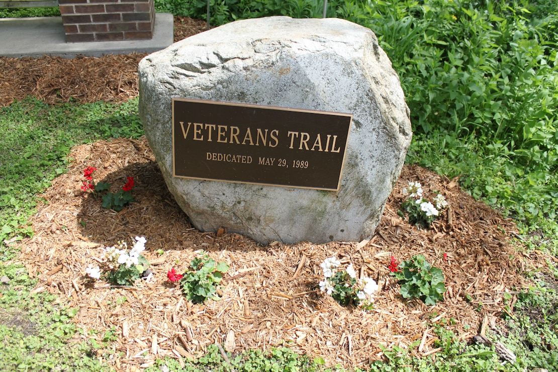 Dedication stone for the Veterans Trail at Coralville Lake
