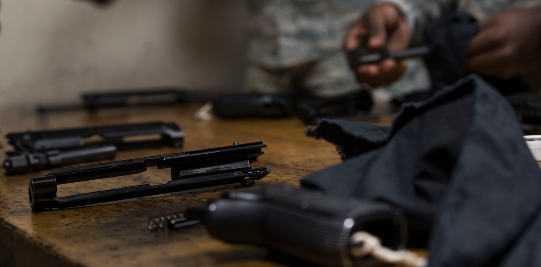 U.S. Air Force Airmen clean their weapons after participating in an inaugural M9 Excellence in Competition shooting event at the Combat Arms range complex at Shaw Air Force Base, South Carolina, Nov. 4, 2019.