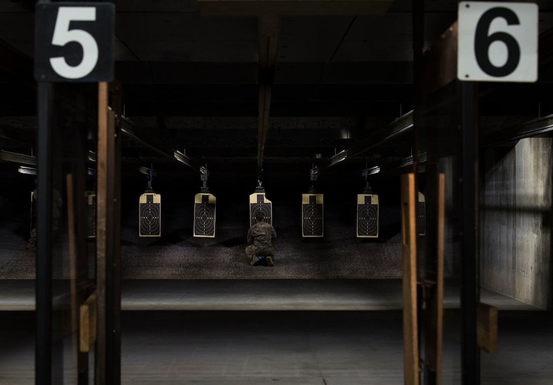 U.S. Air Force Staff Sgt. Troy Maycock, 20th Security Forces combat arms instructor, grades a target from an inaugural M9 pistol Excellence in Competition shooting event at the Combat Arms range complex at Shaw Air Force Base, South Carolina, Nov. 4, 2019.