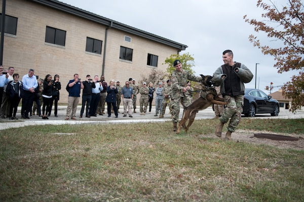 Civic leaders watch a K9 demonstration Nov. 7, 2019, at Joint Base San Antonio-Medina Annex, Texas. During the visit, civic leaders toured missions of 37th Training Wing, 12th Flying Training Wing, 502nd Air Base Wing and Air Force Recruiting Service, all at JBSA locations. The Air Force Civic Leader Program is an Air Staff-level program comprising major command-selected community leaders from a wide variety of industries and sectors, including banking and economic development, construction, manufacturing, education, healthcare, science and technology. The program helps community leaders understand and advocate for the Air Force's diverse missions.