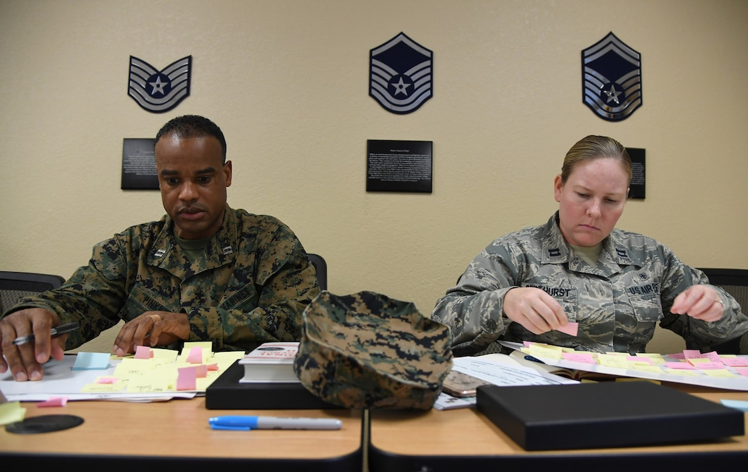 "U.S. Marine Capt. Adam Pinkney, Keesler Marine Detachment commanding officer, and U.S. Air Force Capt. Daria Coulthurst, 81st Medical Support Squadron resource management NCO in charge, participate in ""A Life-Mapping Experience"" exercise during the Leadership Enhancement and Development Seminar inside the Airman Leadership School building at Keesler Air Force Base, Mississippi, Nov. 5, 2019. The three-day course, which is open to all supervisors, is meant to enhance effective communication, skillful interpersonal interaction and emotional intelligence in the military environment by using an active learning format that emphasizes discussion and minimizes lecture. (U.S. Air Force photo by Kemberly Groue)"