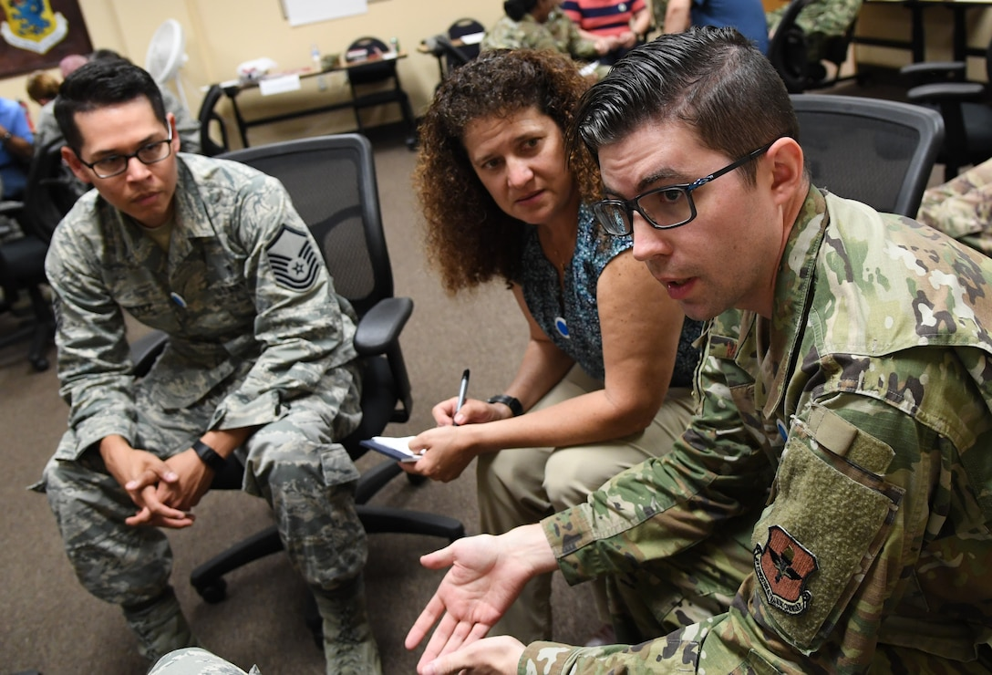 "U.S. Air Force Tech. Sgt. Zach McDaniel, 81st Medical Operations Squadron respiratory therapy NCO in charge, participates in a discussion with fellow students during a ""Star Power"" exercise during the Leadership Enhancement and Development Seminar inside the Airman Leadership School building at Keesler Air Force Base, Mississippi, Nov. 5, 2019. The three-day course, which is open to all supervisors, is meant to enhance effective communication, skillful interpersonal interaction and emotional intelligence in the military environment by using an active learning format that emphasizes discussion and minimizes lecture. (U.S. Air Force photo by Kemberly Groue)"