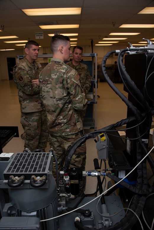 U.S. Air Force Airman 1st Class Brandon Ritenour, center, 60th Maintenance Squadron Precision Measurement Equipment Laboratory technician, briefs Chief Master Sgt. Derek Crowder, left, 60th Air Mobility Wing command chief, and Col. Jeff Nelson, right, 60th AMW commander, about the PMEL mission during a Leadership Rounds visit Nov. 1, 2019 at Travis Air Force Base, California. The PMEL team is responsible for ensuring the accuracy of test equipment for 255 work centers. Leadership Rounds program provides 60th Air Mobility Wing leadership an opportunity to interact with Airmen to get a detailed view of each mission performed at Travis AFB. (U.S. Air Force photo by Tech. Sgt. James Hodgman)