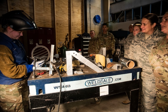 The 53rd Test Support Squadron special devices flight participated in an immersion tour for members assigned to the 325th Fighter Wing on Nov. 8, 2019, at Tyndall Air Force Base, Florida. Airmen visited multiple units of the 53rd Weapons Evaluation Group during the tour, including the metal fabrication shop. The airmen watched as a part was welded by TDY personnel for an aircraft participating in the Weapons System Evaluation Program and Checkered Flag 20-1 exercise on Tyndall's flight line demonstrating the unit's joint partnership with Tyndall, ensuring Airmen are trained and equipment is tested, to support the warfighter. (U.S. Air Force photo by Staff Sgt. Magen M. Reeves)