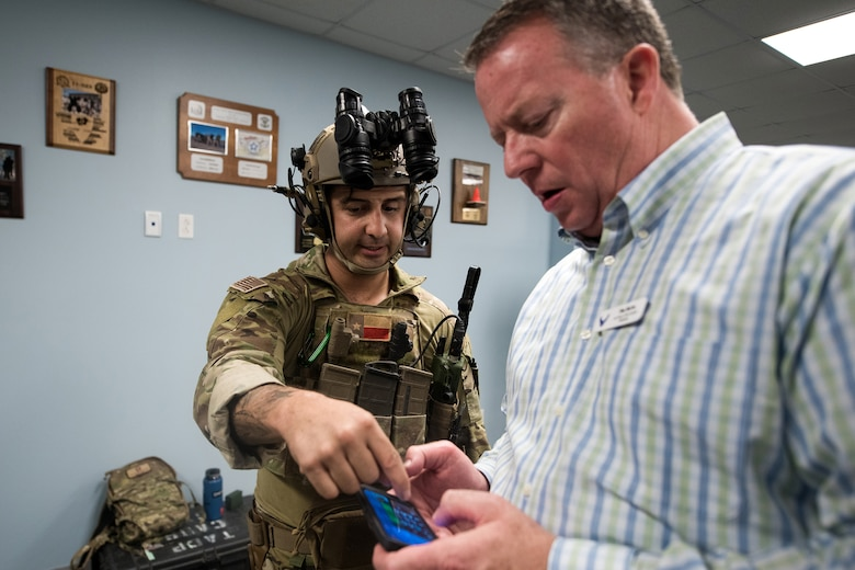 U.S. Air Force Staff Sgt. Nicholas Vead, 353rd Special Warfare Training Wing, Tactical Air Control Party instructor, demonstrates his equipment for Tim Burke, Air National Guard Bureau civic leader from Bellevue, Nebraska, Nov. 7, 2019, at Joint Base San Antonio-Medina Annex, Texas. During the visit, civic leaders toured missions of 37th Training Wing, 12th Flying Training Wing, 502nd Air Base Wing and Air Force Recruiting Service, all at JBSA locations. The Air Force Civic Leader Program is an Air Staff-level program comprising major command-selected community leaders from a wide variety of industries and sectors, including banking and economic development, construction, manufacturing, education, healthcare, science and technology. The program helps community leaders understand and advocate for the Air Force's diverse missions.