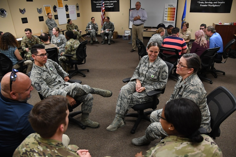 "Keesler personnel participate in a ""Star Power"" exercise during the Leadership Enhancement and Development Seminar inside the Airman Leadership School building at Keesler Air Force Base, Mississippi, Nov. 5, 2019. The three-day course, which is open to all supervisors, is meant to enhance effective communication, skillful interpersonal interaction and emotional intelligence in the military environment by using an active learning format that emphasizes discussion and minimizes lecture. (U.S. Air Force photo by Kemberly Groue)"