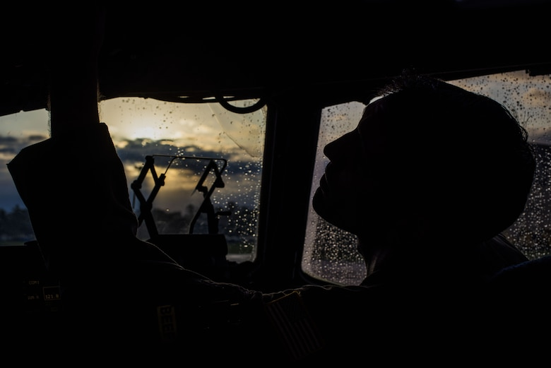U.S. Air Force Capt. Shawn McDonald, 6th Airlift Squadron pilot, checks controls in the cockpit of a C-17 Globemaster III on Joint Base McGuire-Dix-Lakehurst, New Jersey, Nov. 5, 2019. McDonald was preparing the aircraft before takeoff to Fort Sill, Oklahoma, for a joint training exercise with the 3rd Battalion, 2nd Air Defense Artillery Regiment. (U.S. Air Force photo by Airman 1st Class Ariel Owings)