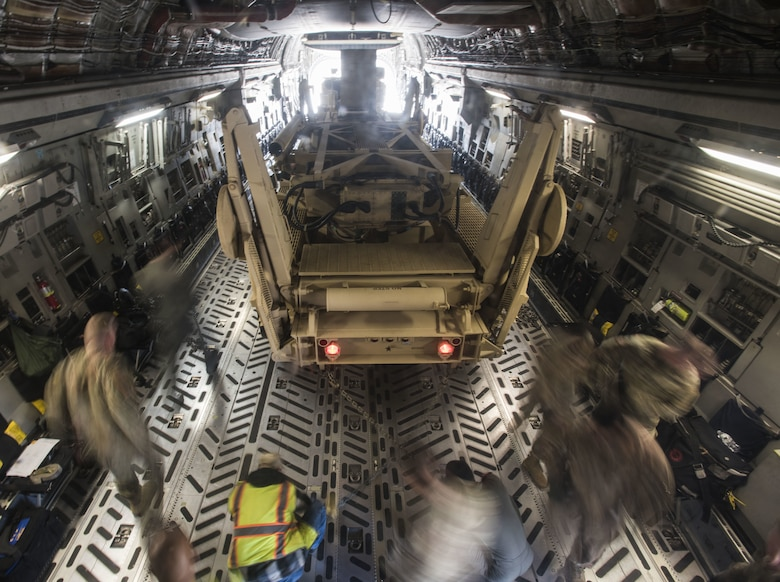Soldiers with the 3rd Battalion, 2nd Air Defense Artillery Regiment assigned to Fort Sill, Oklahoma, and 6th Airlift Squadron Airmen assigned to Joint Base McGuire-Dix-Lakehurst, New Jersey, load a Fort Sill M902 Patriot Missile Launcher pulled by a HEMTT M983A4 Light Equipment Transporter into a Joint Base MDL C-17 Globemaster III, Nov. 5, 2019. The goal of the joint exercise was to familiarize new Soldiers in 3-2 ADA BN with their first hands-on experience of their training. This supports the missions of Rapid Global Mobility and providing fires to protect the force and selected geopolitical assets from aerial attack, missile attack and surveillance. (U.S. Air Force photo by Airman 1st Class Ariel Owings)