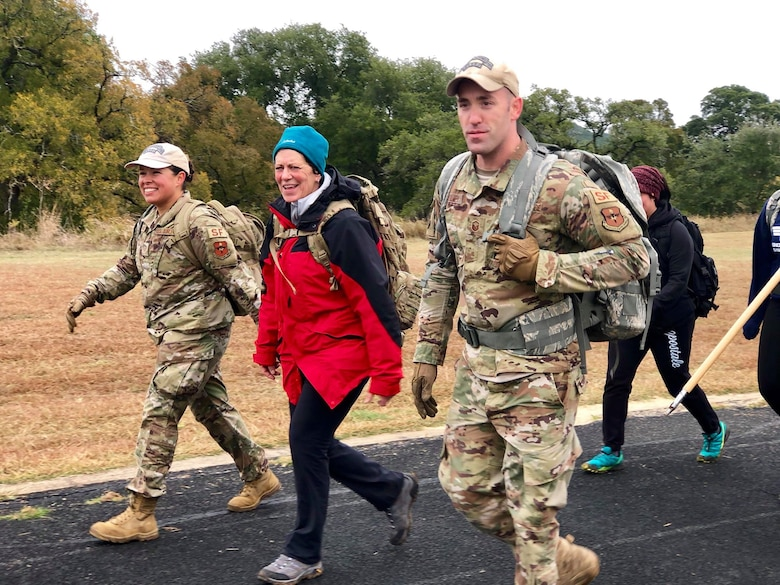 Gold Star Mother, Christine Herwick, and teammates cross the Defender Ruck 2019 finish line. Over 1,100 Security Forces Airmen gathered for the 12th Annual Defender Ruck, hosted by the 343rd Training Squadron, in honor of all 186 Defender Airmen who have made the ultimate sacrifice in defense of freedom, Nov. 8, here.