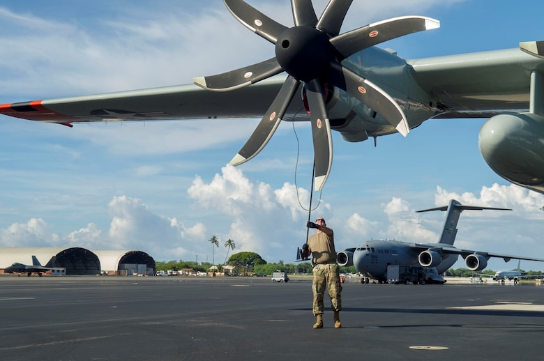 An Airman assigned to the 109th Airlift Wing, Stratton Air National Guard Base, New York, performs pre-flight inspections on the flightline at Joint Base Pearl Harbor-Hickam, Hawaii, Oct. 31, 2019. All the LC-130 aircraft need to be in theater in a timely fashion to support the National Science Foundation's mission. Pacific Air Forces operates on a 24-hour basis to provide complete joint operational and logistic support for the National Science Foundation-managed U.S. Antarctic Program (USAP). Operation DEEP FREEZE is the U.S. military's contribution to the civilian-managed USAP. (U.S. Air Force photo by Staff Sgt. Mikaley Kline)