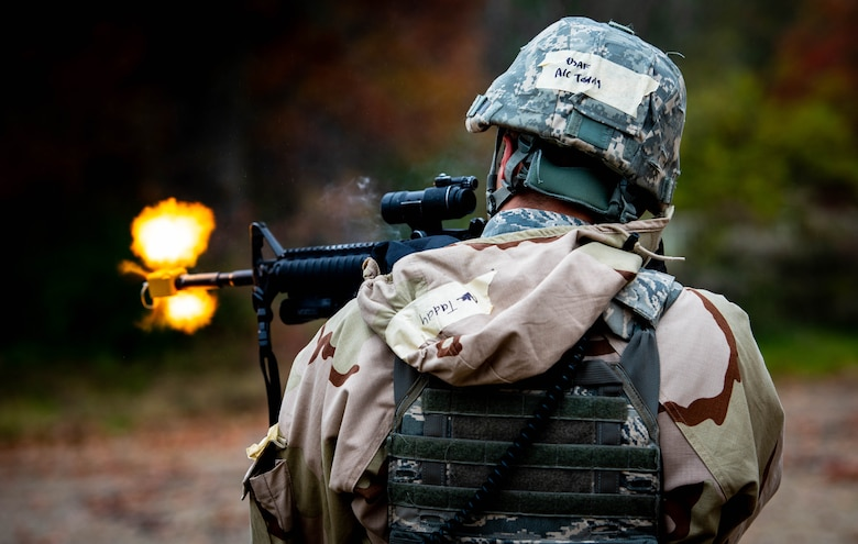 Airman 1st Class Alec Taddy, 375th Security Forces Squadron entry controller, fires a blank firearm cartridge during a mobility exercise at Scott Air Force Base, Ill., Nov. 6, 2019. The MOBEX allowed Airmen to practice their response to challenges such as combat and chemical warfare. (U.S. Air Force photo by Senior Airman Tara Stetler)