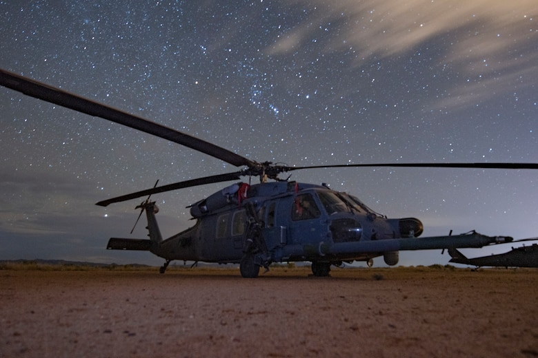 A U.S. Air Force HH-60G Pave Hawk from the 66th Rescue Squadron cloaks under the cover of darkness while exercising the Dynamic Wing concept