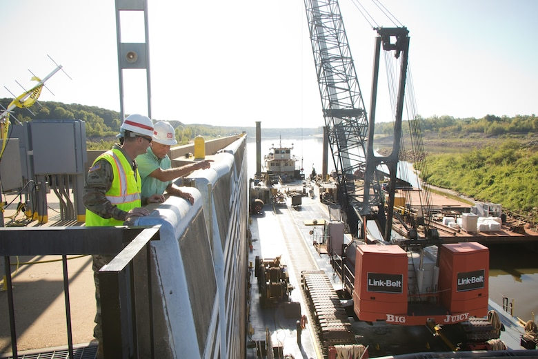 U.S. Army Corps of Engineers Vicksburg District Commander Col. Robert A. Hilliard speaks with a district engineer regarding the complete dewatering of the John H. Overton Lock and Dam, located on the Red River near Alexandria, Louisiana, Sept. 26.