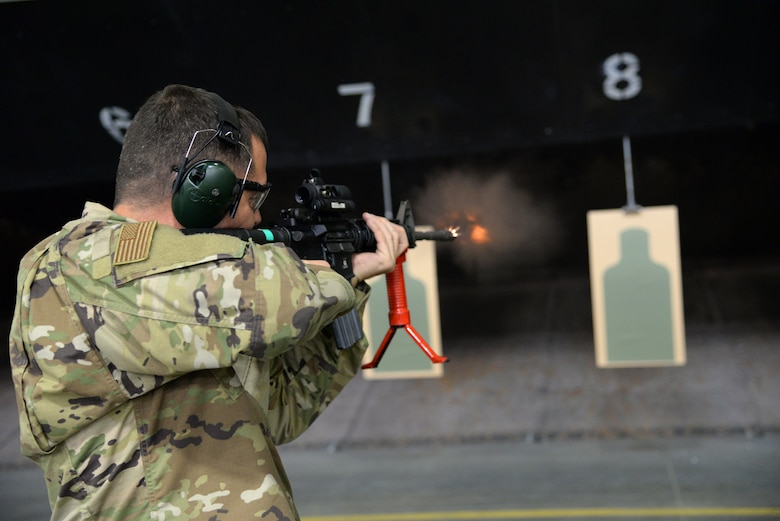 A picture of U.S. Air Force Lieutenant Colonel Joseph Leonard, 177th Maintenance Group commander, firing the M4 carbine at a firing range.