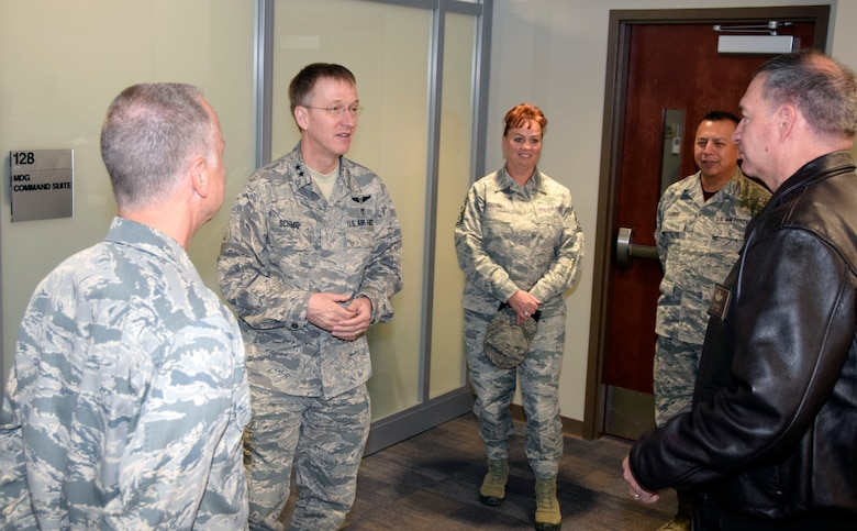 Maj. Gen. (Dr.) Josef Schmid III, mobilization assistant to the surgeon general of the Air Force, Headquarters U.S. Air Force, Washington, D.C., speaks with Col. Michael C. Brice, 433rd Medical Group commander, Chief Master Sgt. Shana C. Cullum, 433rd Airlift Wing command chief, Chief Master Sgt. Ernesto Flores Jr., 433rd MDG superintendent and Col. Terry W. McClain, 433rd AW commander, during a visit of the medical group at Joint Base San Antonio-Lackland, Texas Nov. 2, 2019.
