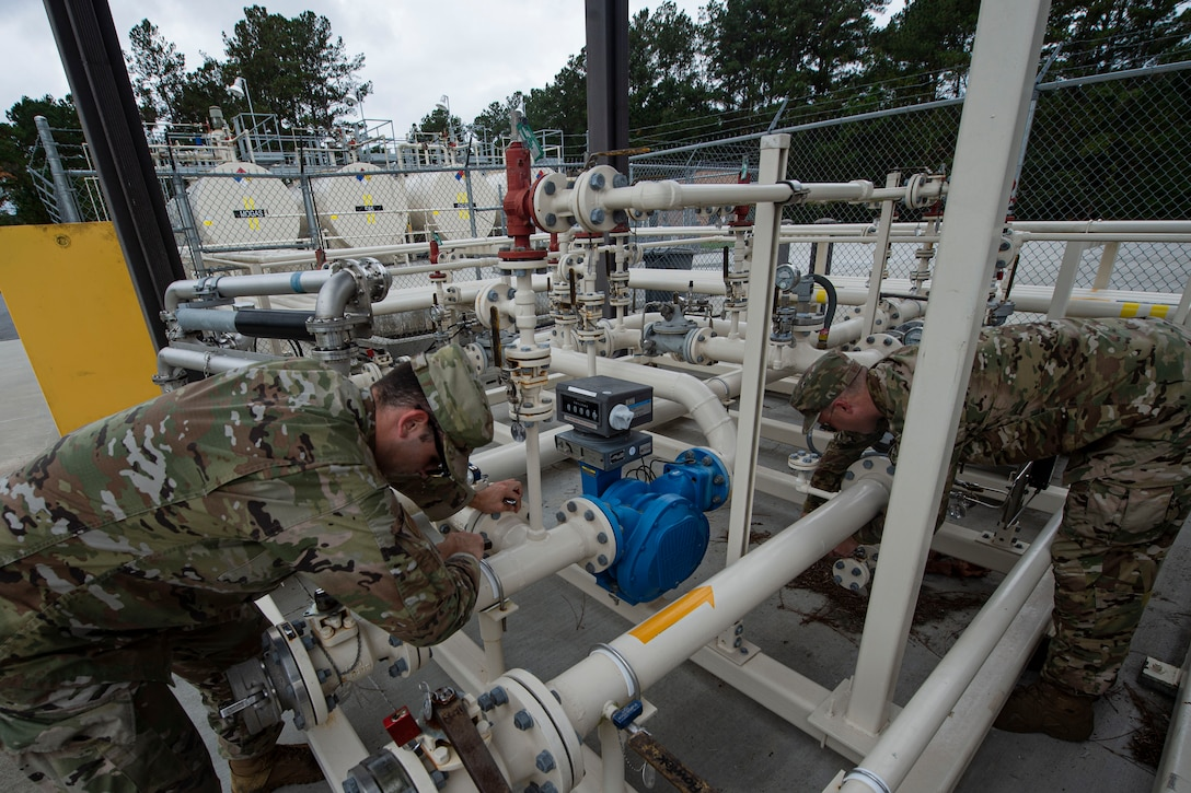 Senior Airman Gavin Rees, left, 23d Logistics Readiness Squadron (LRS) fuels facilities technician, and Staff Sgt. Bryan White, 23d LRS fuels facilities NCO in charge, check operating valves Oct. 30, 2019, at Moody Air Force Base, Ga. The 23d LRS fuels facilities is responsible for maintaining facilities, product purity, storage and accountability. Fuels facilities Airmen maintain the base service station by performing routine checks on the operating valves, fuel tanks and service station parts. (U.S. Air Force photo by Airman Azaria E. Foster)