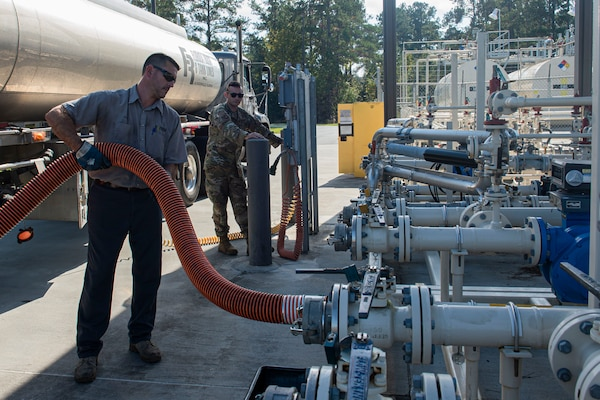 Brent Deas, Florida Rock & Tank Lines Incorporated truck driver, holds a hose while refueling tanks Nov. 6, 2019, at Moody Air Force Base, Ga. The 23d LRS fuels facilities is responsible for maintaining facilities, product purity, storage and accountability. Fuels facilities Airmen maintain the base service station by performing routine checks on the operating valves, fuel tanks and service station parts. (U.S. Air Force photo by Airman Azaria E. Foster)