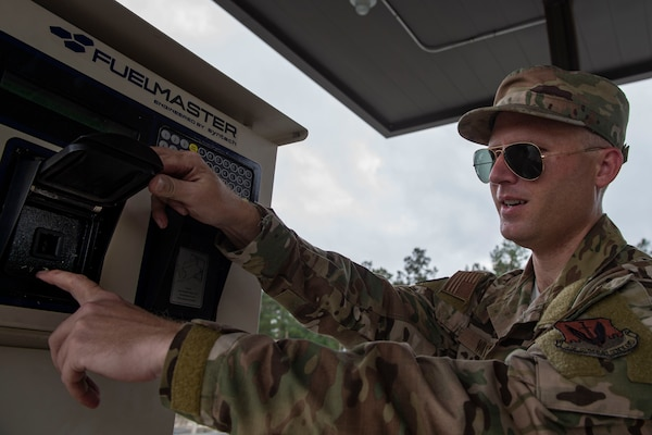 Staff Sgt. Bryan White, 23d Logistics Readiness Squadron (LRS) fuels facilities NCO in charge, checks a vehicle interface link socket for damage Oct. 30, 2019, at Moody Air Force Base, Ga. The 23d LRS fuels facilities is responsible for maintaining facilities, product purity, storage and accountability. Fuels facilities Airmen maintain the base service station by performing routine checks on the operating valves, fuel tanks and service station parts. (U.S. Air Force photo by Airman Azaria E. Foster)