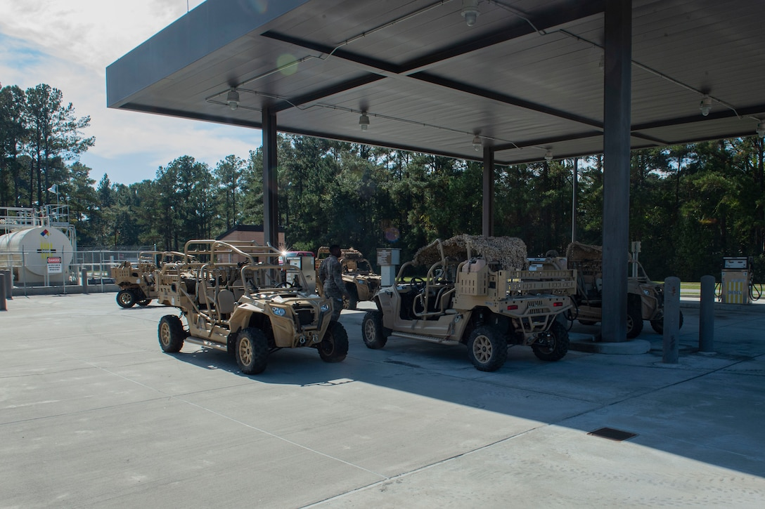 Airmen use the base service station to refuel government owned vehicles Nov. 6, 2019, at Moody Air Force Base, Ga. The 23d LRS fuels facilities is responsible for maintaining facilities, product purity, storage and accountability. Fuels facilities Airmen maintain the base service station by performing routine checks on the operating valves, fuel tanks and service station parts. (U.S. Air Force photo by Airman Azaria E. Foster)