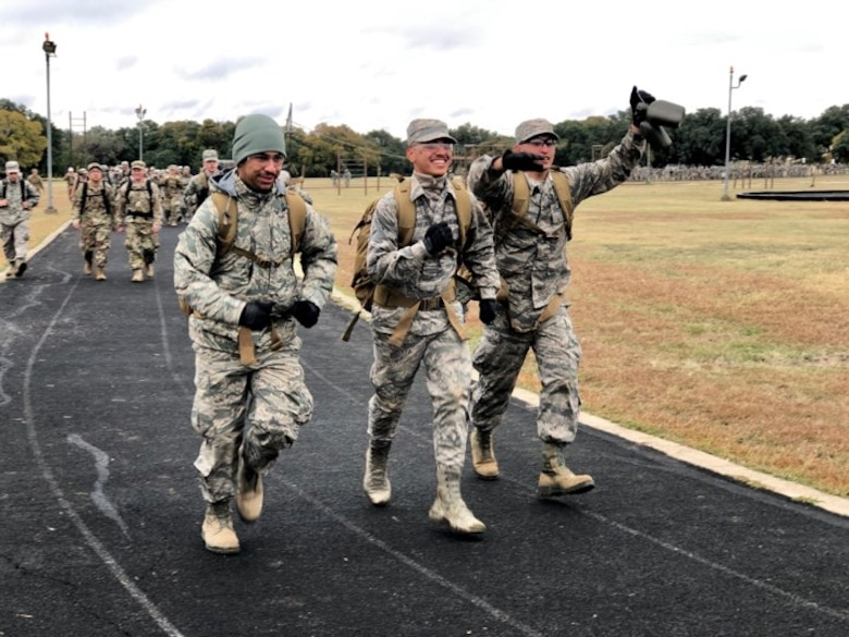 Security Forces Airmen celebrate crossing the finish line after a 4-mile ruck. Over 1,100 Security Forces Airmen gathered for the 12th Annual Defender Ruck, hosted by the 343rd Training Squadron, in honor of all 186 Defender Airmen who have made the ultimate sacrifice in defense of freedom, Nov. 8, here.