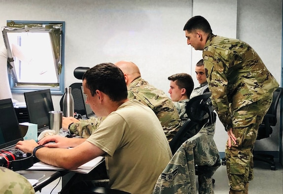Members of the 552nd Air Control Networks Squadron participate in the Air Force's first mission qualification training course for mission defense teams in Oct. 2019. Nine 552nd ACNS members graduated this course, qualifying them to be operators on the Cyberspace Vulnerability Assessment/Hunter Weapon System.