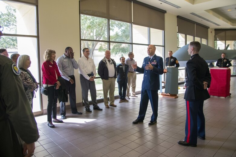 U.S. Air Force Lt. Col. Eric Bissonette welcomes civic leaders to his unit, the 558th Flying Training Squadron, during its observation of the Marine Corps birthday Nov. 6, 2019. During the visit, civic leaders toured missions of 37th Training Wing, 12th Flying Training Wing, 502nd Air Base Wing and Air Force Recruiting Service, all at JBSA locations. The Air Force Civic Leader Program is an Air Staff-level program comprising major command-selected community leaders from a wide variety of industries and sectors, including banking and economic development, construction, manufacturing, education, healthcare, science and technology.