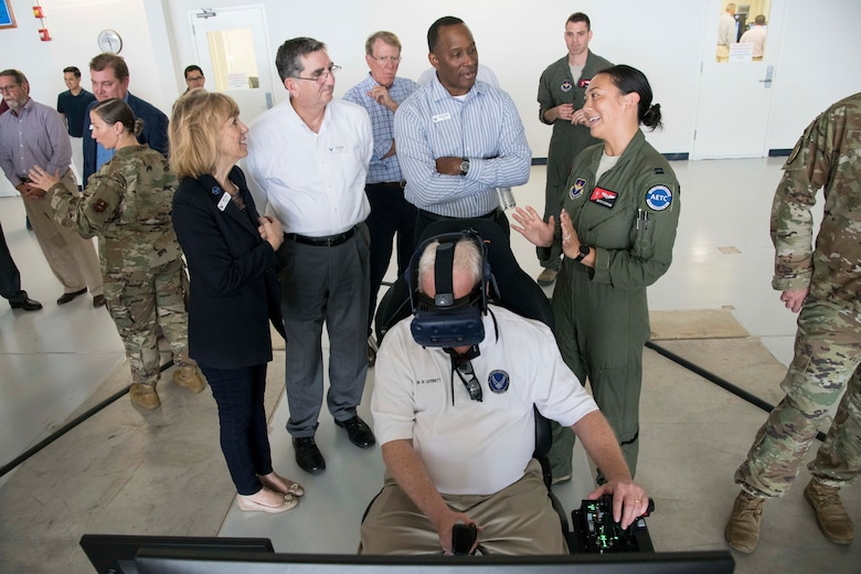 While Dr. Joe Leverett, an Air Education and Training Command civic leader from Altus, Oklahoma, uses the virtual reality system, U.S. Air Force Capt. Christine Durham, Detachment 24 instructor pilot, explains to other civic leaders about how the system is used to train Pilot Training Next students Nov. 6, 2019. During the visit, civic leaders toured missions of the 37th Training Wing, 12th Flying Training Wing, 502nd Air Base Wing and Air Force Recruiting Service, at Joint Base San Antonio. The Air Force Civic Leader Tour Program helps community leaders understand and advocate for the Air Force's diverse missions.
