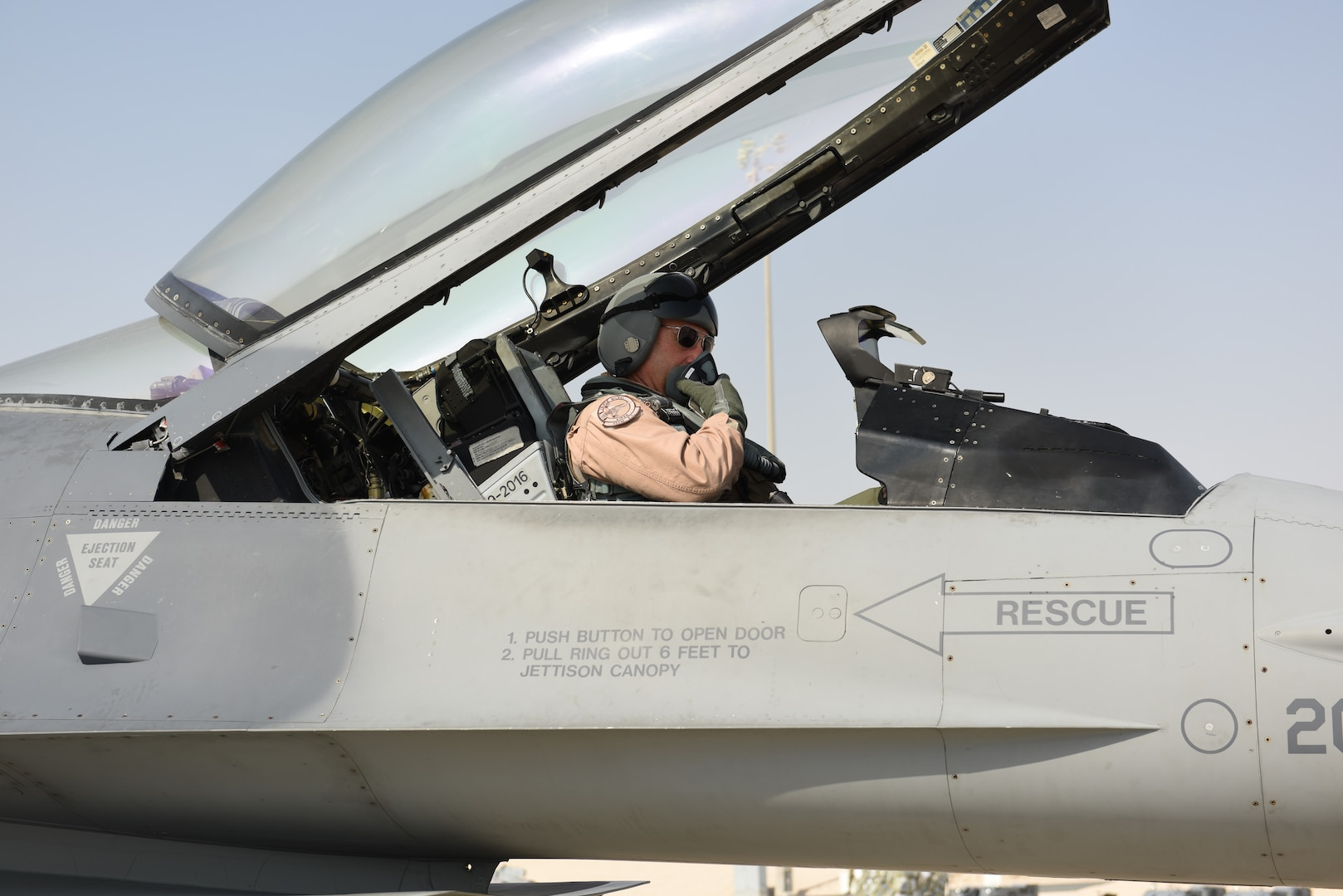 U.S. Air Force Lt. Gen. Joseph Guastella, commander of U.S. Air Forces Central Command and former commander of the 555th Fighter Squadron from October 2003 to July 2005, prepares for his flight in an F-16 Fighting Falcon at Al Udeid Air Base, Qatar Nov. 4, 2019.