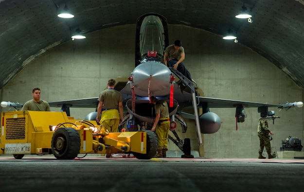 U.S. Air Force Airmen from the 52nd Aircraft Maintenance Squadron, perform postflight maintenance on an F-16 Fighting Falcon during Blue Flag 2019 at Uvda Air Base, Israel, November 6, 2019. Twelve F-16s along with approximately 250 personnel from the 52nd Fighter Wing deployed to Israel to support the exercise. (U.S. Air Force photo by Airman 1st Class Kyle Cope)