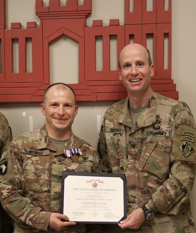 MAJ Christopher George is presented a Defense Meritorious Service Medal from USACE Afghanistan District Commander, Chris Becking, for leading the New York-based FEST-A team while deployed to Afghanistan.