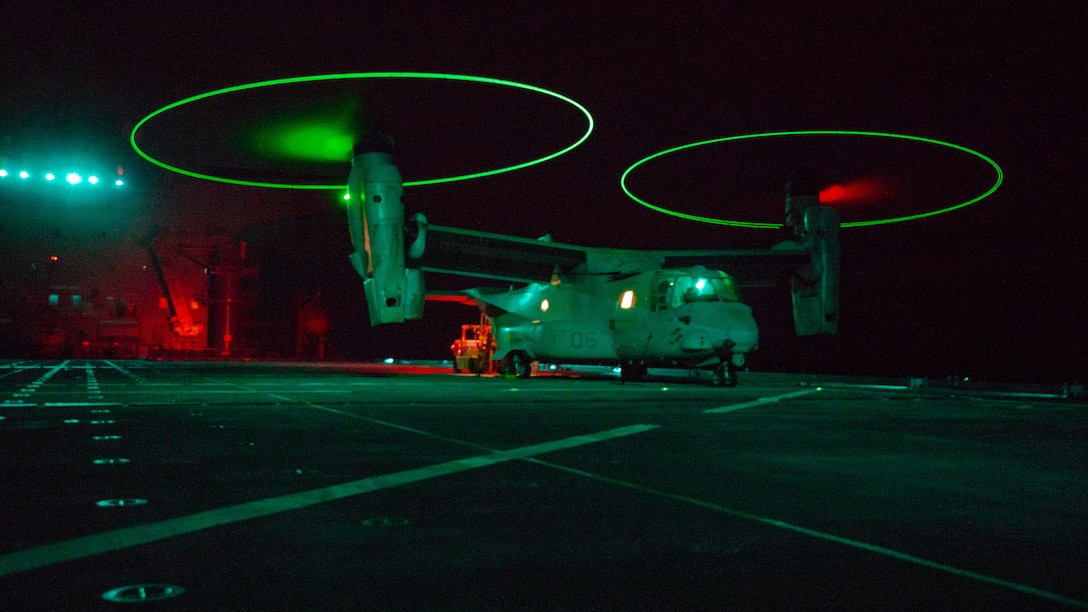 U.S. Marines assigned to Medium Tiltrotor Squadron 161, attached to Special Purpose Marine Air-Ground Task Force-Crisis Response-Central Command 19.2, conduct MV-22 Osprey night landing qualifications, logistics support, and refueling operations with expeditionary staging base USS Lewis B. Puller in an undisclosed location, Nov. 2, 2019. The SPMAGTF-CR-CC is a quick reaction force, prepared to deploy a variety of capabilities across the region.
